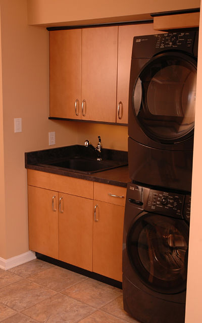 laundry room with stackable washer and dryer