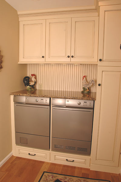 Laundry Room With White Cabinets And Granite Countertop
