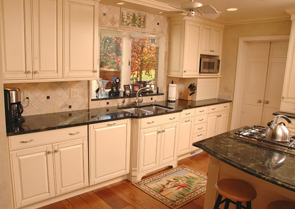 kitchen with raised panel cabinets and granite counters
