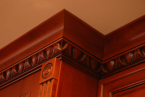 curved crown molding and carved trim embellishments