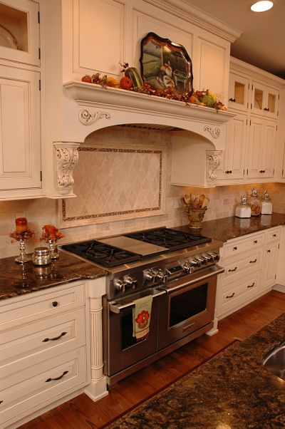 traditional kitchen with custom paneled hood