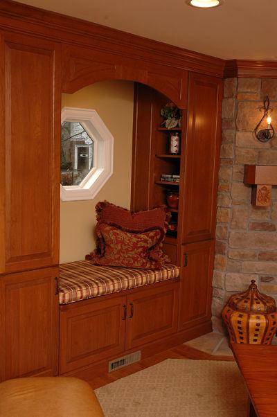 custom window seat with cabinets