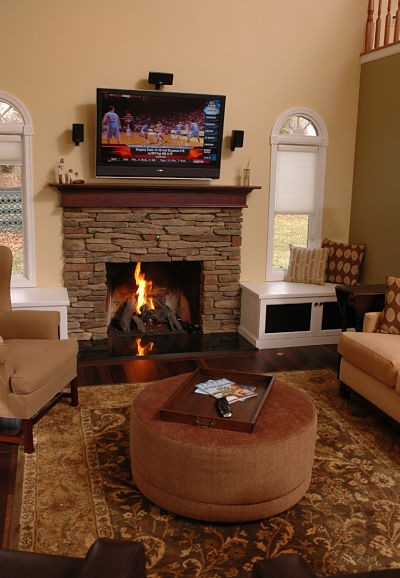 two window seats frame a fireplace