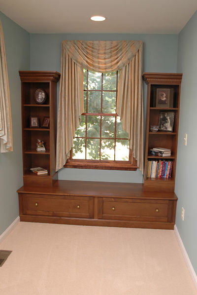 window seat with built-in display cabinets