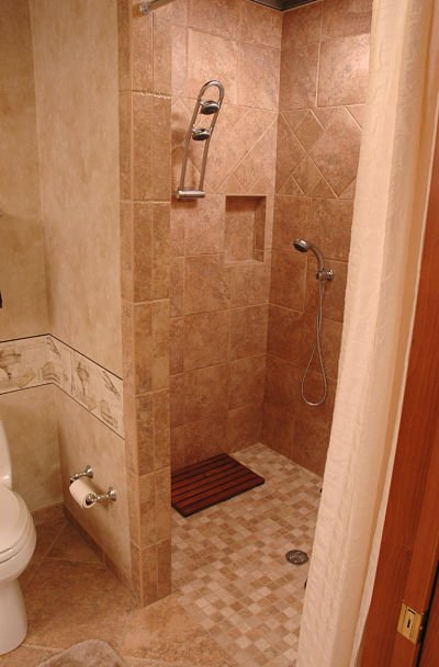 Need more living space check out these lower level remodels Doorless shower designs for small bathrooms