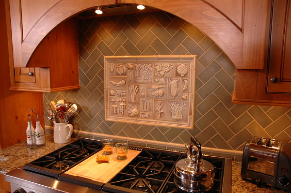 Kitchen with Herringbone Field Tile and Relief Tile Inset