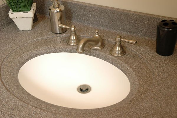 white integrated bathroom sink with gray solid surface counter