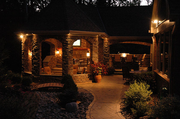 outdoor living space with night lighting