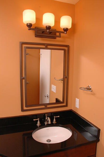 Half Bath with Elegant Mirror