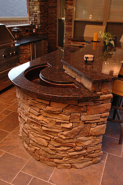 outdoor kitchen with crescent moon shaped sink