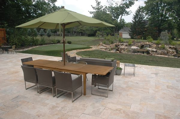 stone patio with water feature and putting green