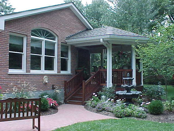 sheltered porch with fountain and gardens