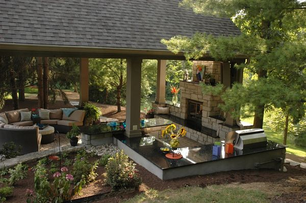outdoor room with kitchen and fireplace