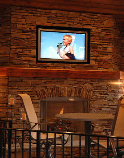 ledgestone outdoor fireplace with wood mantel