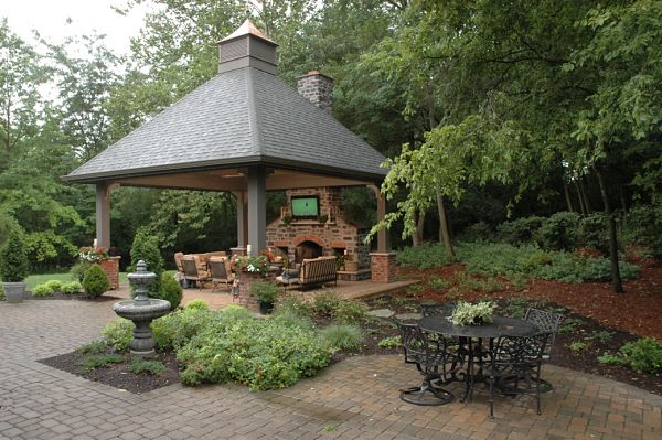 stone and brick fireplace in outdoor shelter