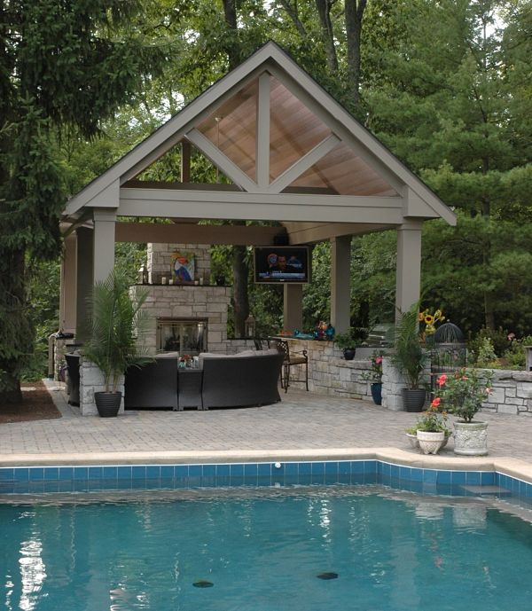 stone fireplace in poolside shelter