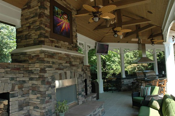 wood-burning stone fireplace in veranda