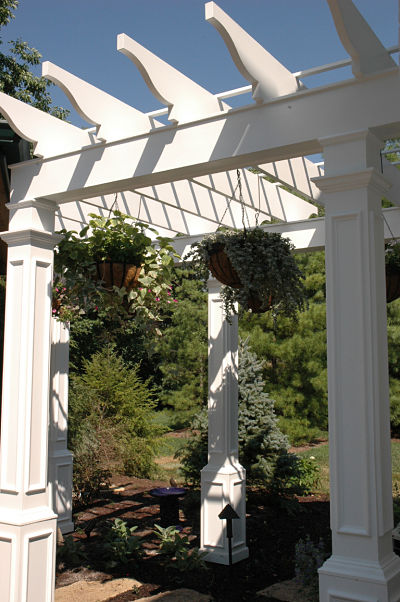 white arbor with ten-foot support columns
