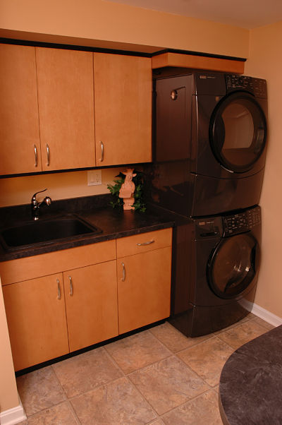 basement laundry area and cabinets