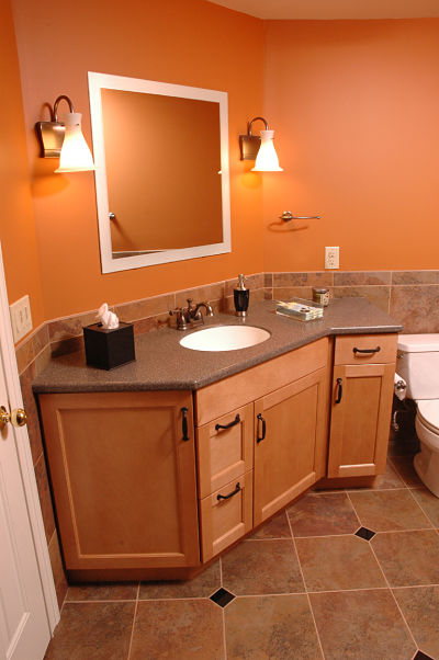 basement bathroom with large vanity sink
