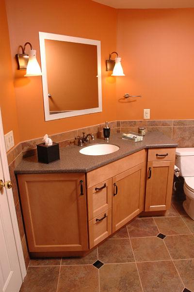 basement bathroom with large vanity sink