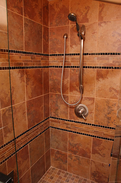 non-slip bathroom flooring with tile molding and quartz shower threshold