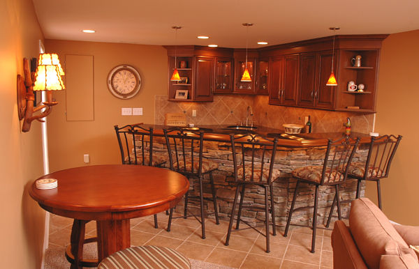 basement kitchen with pendant and recessed lights