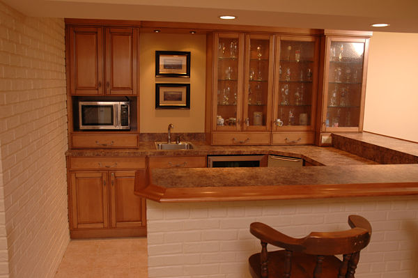 basement kitchen with tiered laminate counter