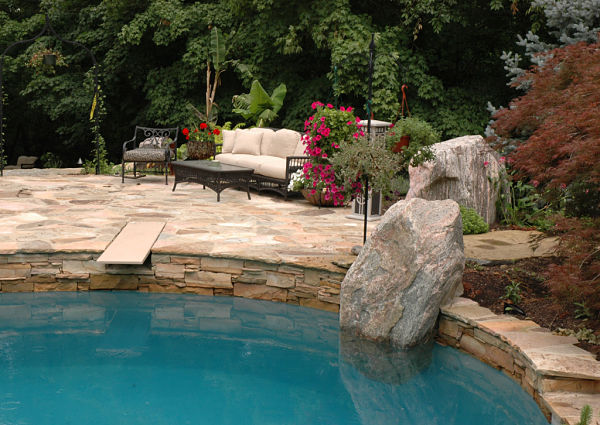 pool with boulder accent