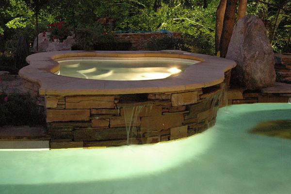 custom hot tub flowing into pool