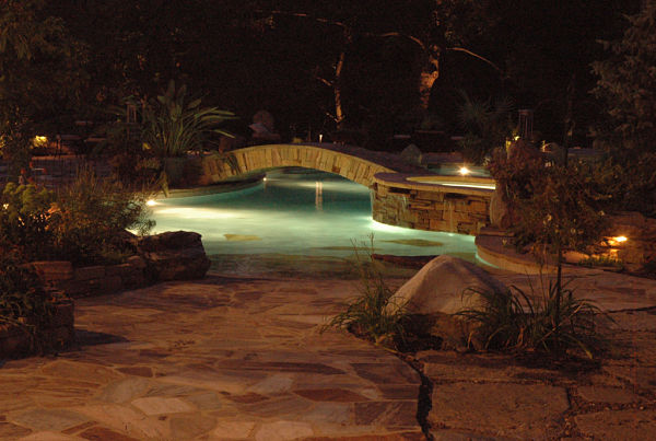 pool and patio with night lighting