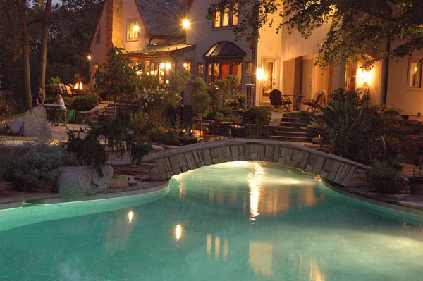backyard pool landscaping and night lighting