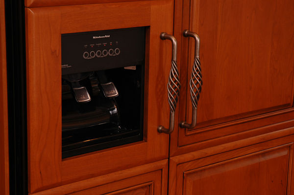decorative pulls on cabinet paneled refrigerator doors