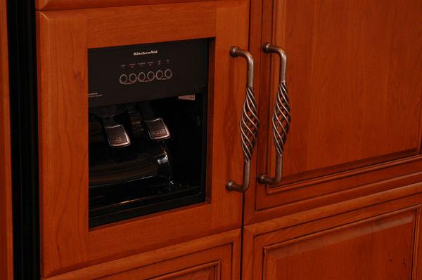 decorative pulls on cabinet paneled refrigerator doors