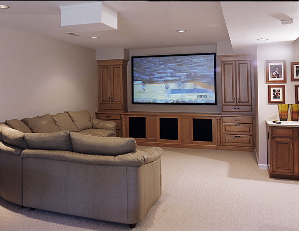 basement home theater with front projector screen