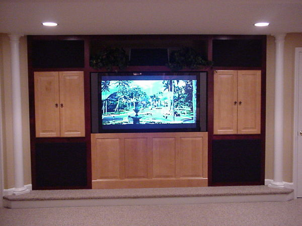 basement home theater with custom cabinets