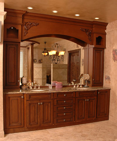 master bath with decorative lighting and large framed mirror
