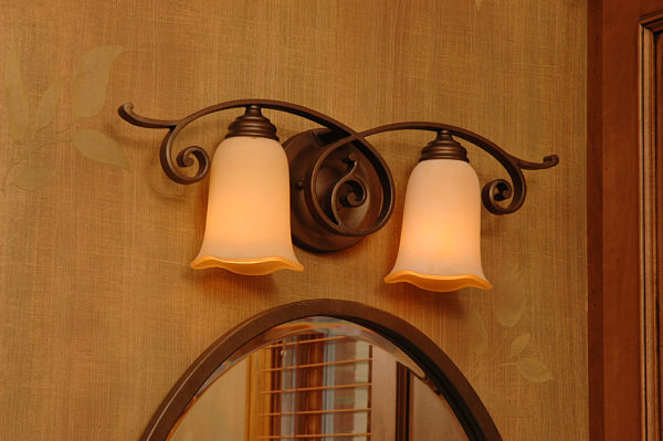Matching bathroom light fixture and mirror.