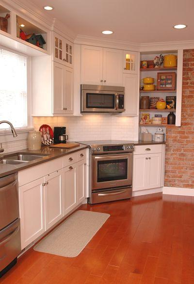 galley kitchen with wide plank flooring