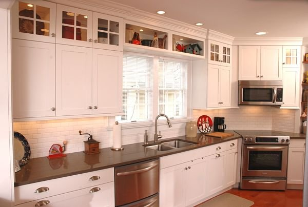 galley kitchen with shaker style cabinets