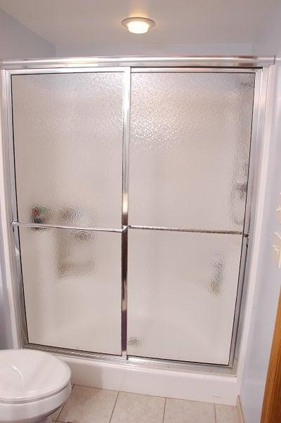 walk-in shower with sliding doors