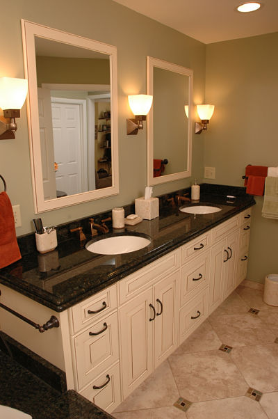 bathroom vanity with two sinks and mirrors