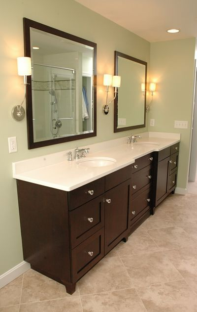 vanity with two sinks and mirrors