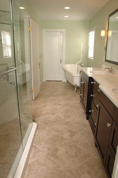 master bath with vanity and soaking tub