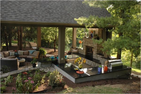 pavilion with outdoor cooking area and retaining wall