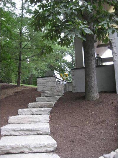 stone stairway to backyard pavilion