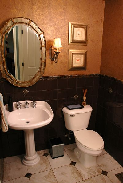 half bath with pedestal sink and comfort height toilet