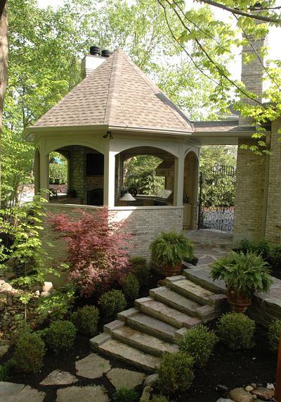 gazebo with stone stairway and garden