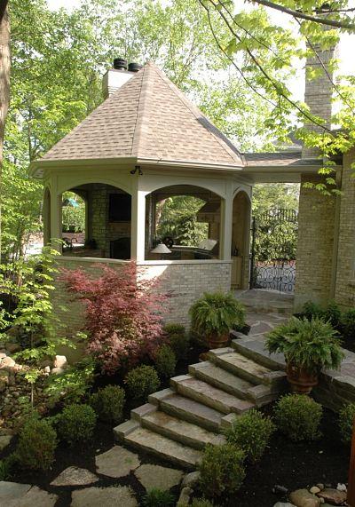 gazebo with stone stairway and garden