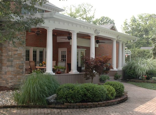 veranda with brick pathway and garden